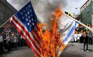 İRAN'DA; AMERİKA, BRİTANYA VE İSRAİL BAYRAKLARINI YAKMAK İÇİN ÜRETİM YAPAN BİR FABRİKA VAR